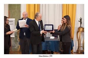 """Guido Mastroianni (presentatore della Cerimonia di premiazione), lo scrittore Riccardo Dri e Chiara Ricci (Presidente dell'Associazione Culturale """"Piazza Navona"""")"""